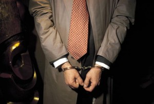 Person under arrest with handcuffs