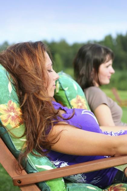 woman sitting in lawn chair